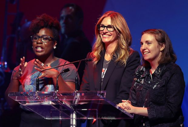 NEW YORK, NY - OCTOBER 17: (L-R) Actresses Uzo Aduba, Julia Roberts and Lena Dunham appear on stage during the Hillary Victory Fund - Stronger Together concert at St. James Theatre on October 17, 2016 in New York City. Broadway stars and celebrities performed during a fundraising concert for the Hillary Clinton campaign. (Photo by Justin Sullivan/Getty Images)