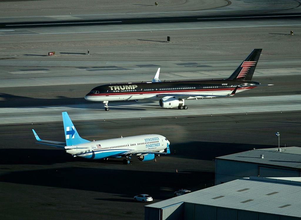 Donald Trump's plane appearing much larger as it passes Democratic presidential nominee Hillary Clinton's campaign plane at McCarran International Airport in Las Vegas, Nevada. (Photo credit: Brendan Smialowski/AFP/Getty Images)