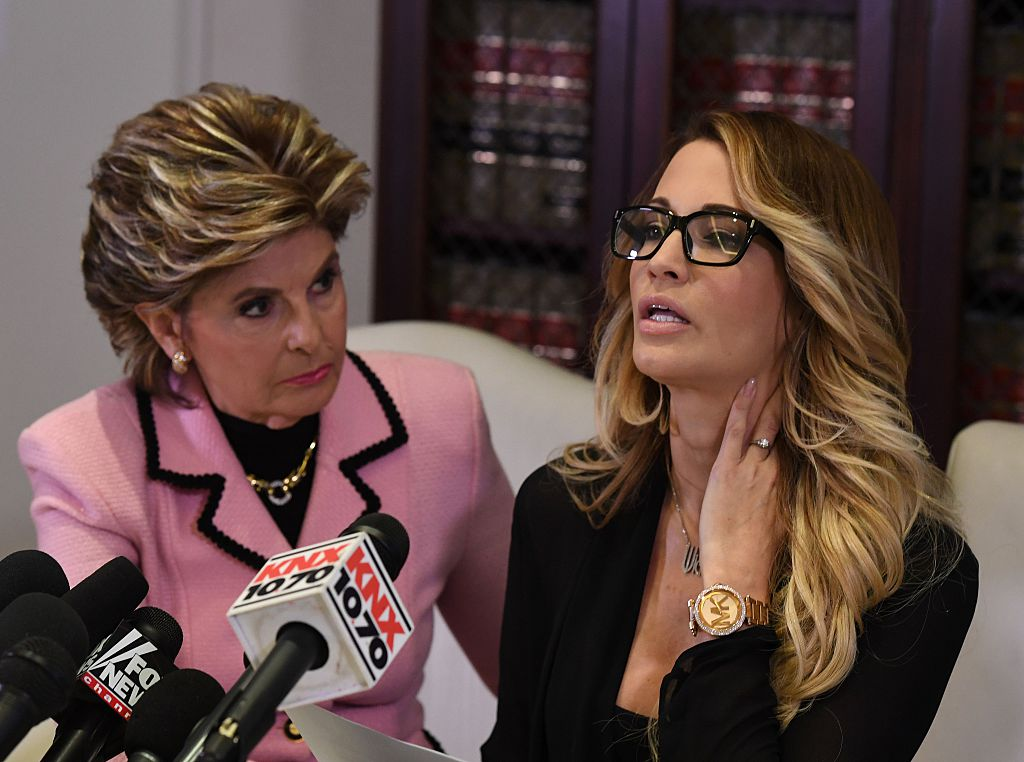 jessica drake (R), speaks beside attorney Gloria Allred (L) about allegations of sexual misconduct against Republican presidential hopeful Donald Trump during a press conference on October 22, 2016. (Photo credit: Mark Ralston/AFP/Getty Images)