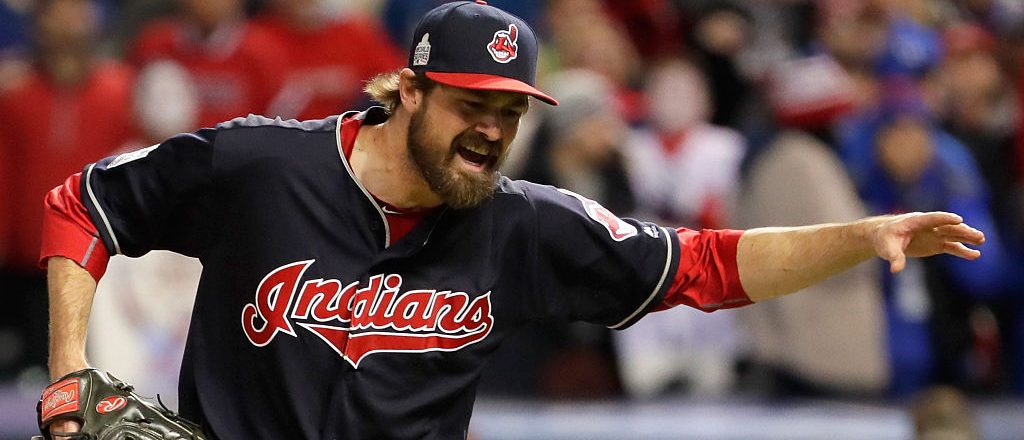 Andrew Miller #24 of the Cleveland Indians reacts after retiring the side with the bases loaded by striking out David Ross #3 of the Chicago Cubs (not pictured) during the seventh inning against the Chicago Cubs in Game One of the 2016 World Series at Progressive Field on October 25, 2016 in Cleveland, Ohio