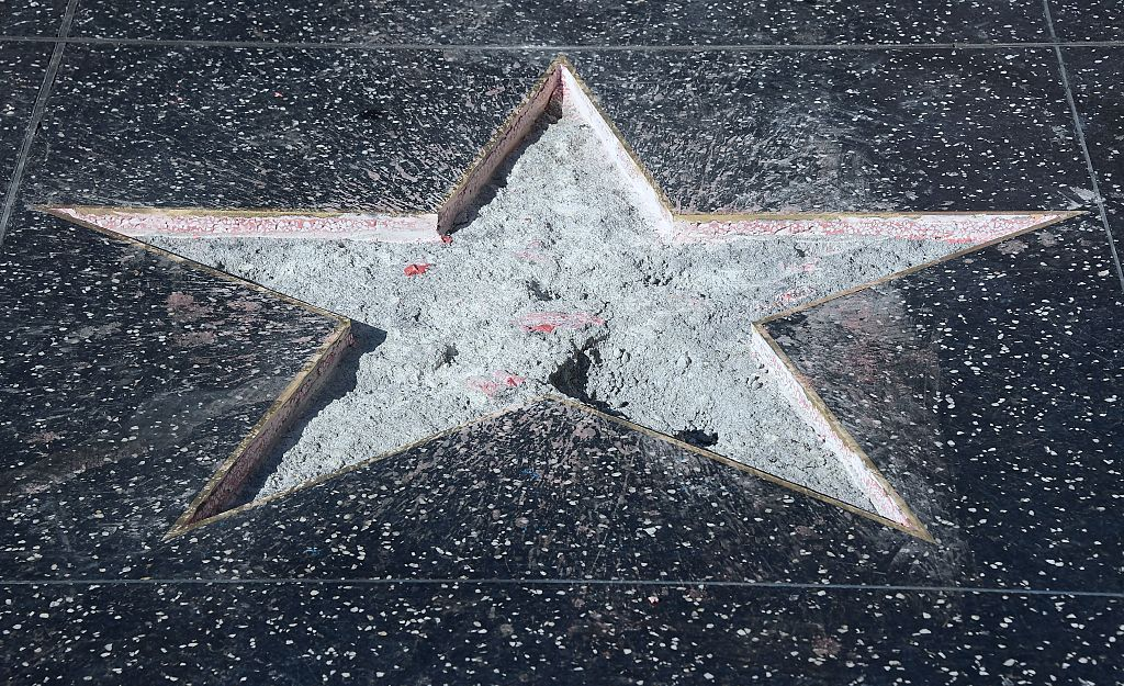 Donald Trump's vandalized Star along the Hollywood Walk of Fame is repaired and cleaned up before being replaced. (Photo credit: FREDERIC J. BROWN/AFP/Getty Images)