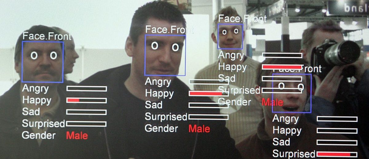 "A photo of a computer screen running ""Real Time Face Detector"" software shows visitors' expressions analysed and explained in real time at the stand of the Fraunhofer Institute at the CeBIT trade fair in Hanover on March 6, 2008. [JOHN MACDOUGALL/AFP/Getty Images]"