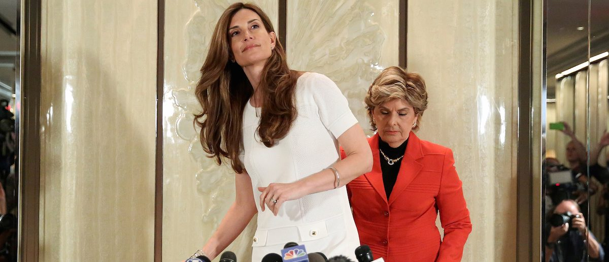 Lawyer Gloria Allred and Karena Virginia (L), who claimed to be the victim of sexual assault by Republican presidential candidate Trump back in 1998, arrive for a news conference in the Manhattan borough of New York, October 20, 2016.   REUTERS/Carlo Allegri