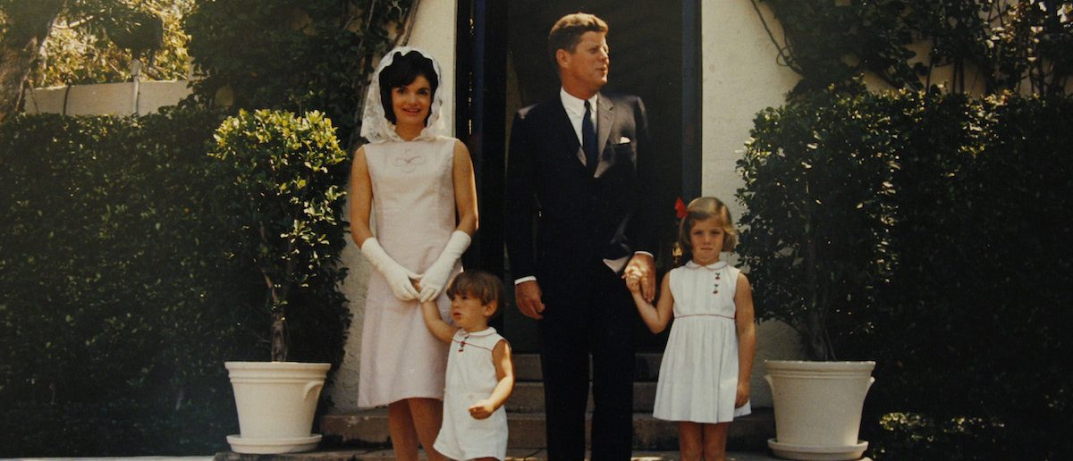 A photograph of former President John F. Kennedy, his wife Jacqueline Kennedy Onassis and their two children Caroline (R) and John, Jr. (L) is displayed before an upcoming Bonhams auction in New York, December 7, 2010
