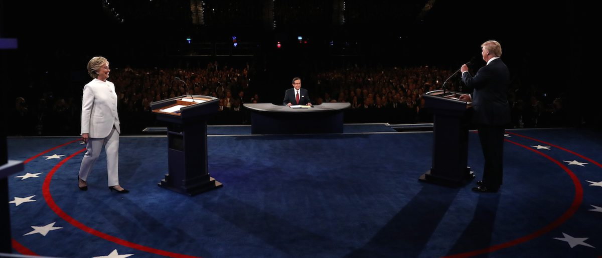 Republican presidential nominee Donald Trump and Democratic presidential nominee Hillary Clinton keep their distance and do not shake hands at the start of the their third and final 2016 presidential campaign debate at UNLV in Las Vegas, Nevada, October 19, 2016