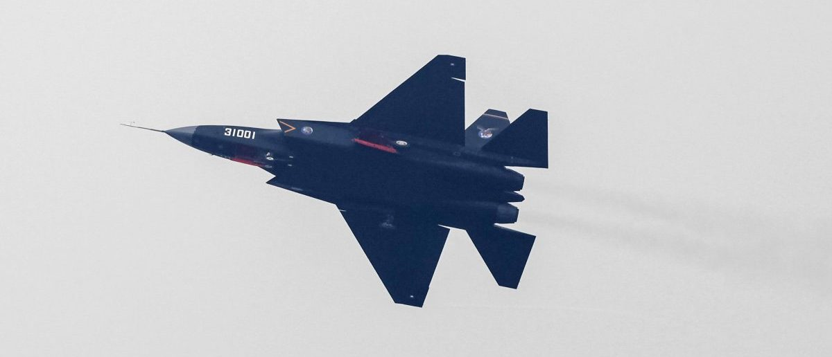 A J-31 stealth fighter of the Chinese People's Liberation Army Air Force is seen during a test flight ahead of the 10th China International Aviation and Aerospace Exhibition in Zhuhai, Guangdong province, November 10, 2014. More than 130 planes will attend the six-day air show starting on Tuesday, Xinhua News Agency reported. REUTERS/Alex Lee