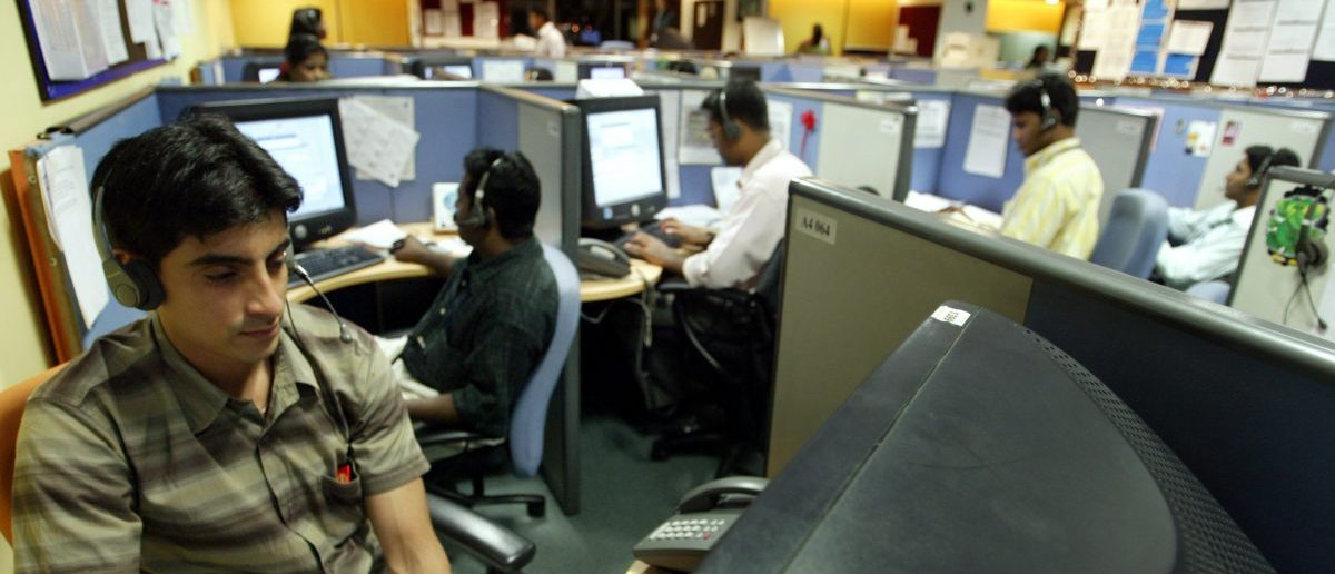 Indian employees at a call center in the southern city of Bangalore March 17, 2004. REUTERS/Sherwin Crasto
