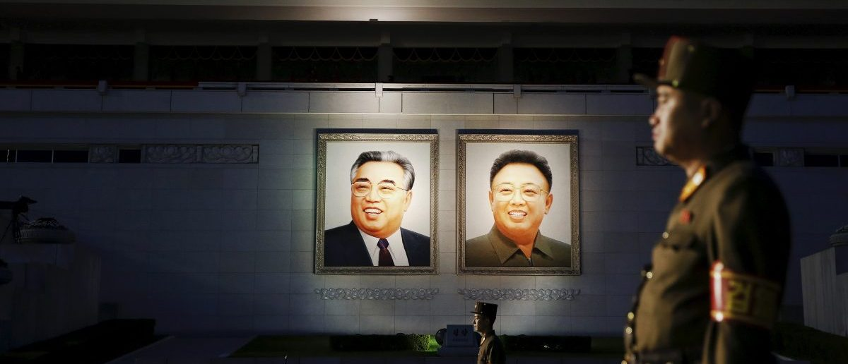 Soldiers guard a grand stand decorated with portraits of North Korea's founder Kim Il-sung (L) and former leader Kim Jong-il. REUTERS/Damir Sagolj