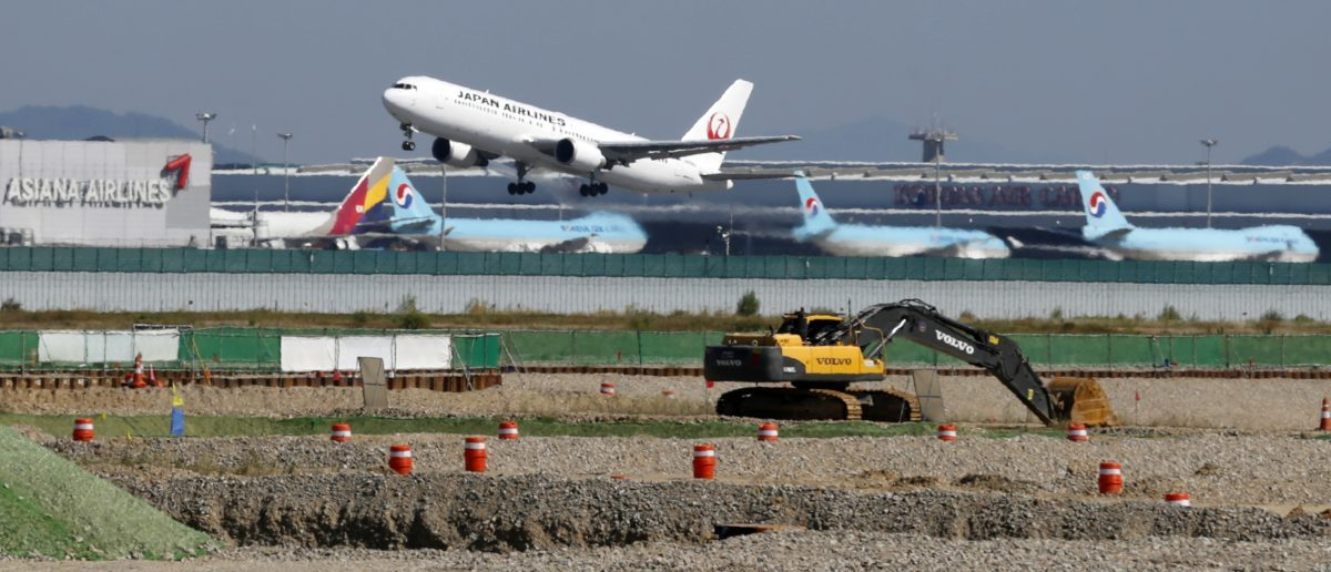 A Japan Airlines airplane takes off during a groundbreaking ceremony for a second terminal of the Incheon Airport in Incheon, west of Seoul September 26, 2013. REUTERS/Lee Jae-Won