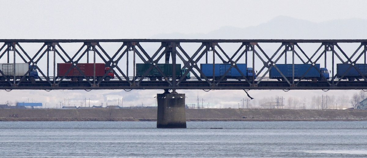 Trucks drive on the Friendship Bridge over the Yalu River which connects North Korea's Sinuiju to China's Dandong, April 11, 2013. Picture taken April 11, 2013. REUTERS/Jacky Chen