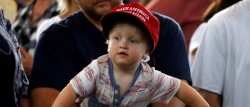 """A baby waits for Republican nominee Donald Trump to speak at """"Joni's Roast and Ride"""" in Des Moines"""