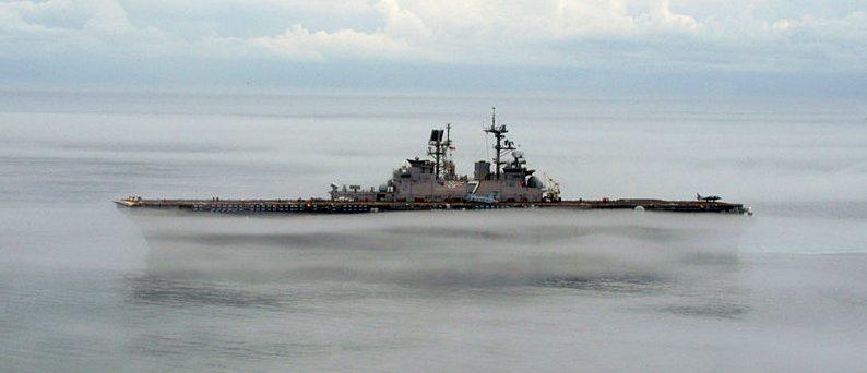 The amphibious assault ship USS Iwo Jima (LHD 7) shown operating in dense fog in the Atlantic Ocean