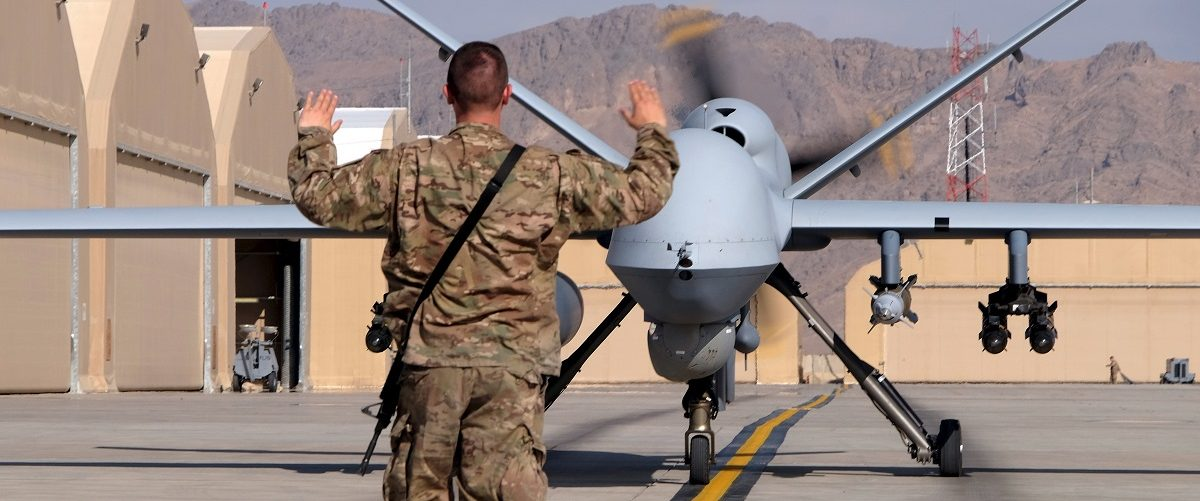 A U.S. airman guides a U.S. Air Force MQ-9 Reaper drone as it taxis to the runway at Kandahar Airfield, Afghanistan March 9, 2016.  REUTERS/Josh Smith.