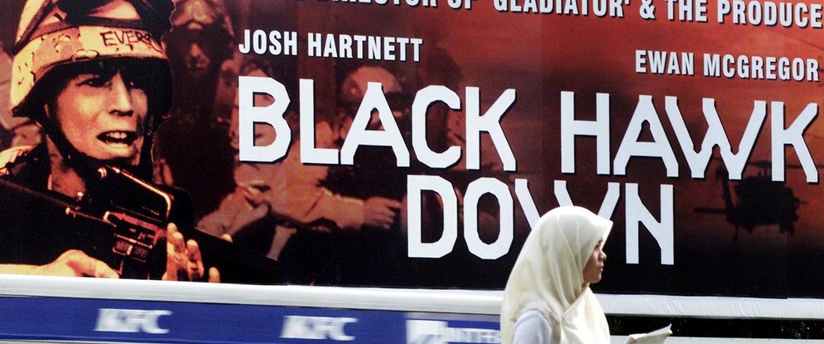 "Malaysian lady in front of a ""Black Hawk Down"" billboard."