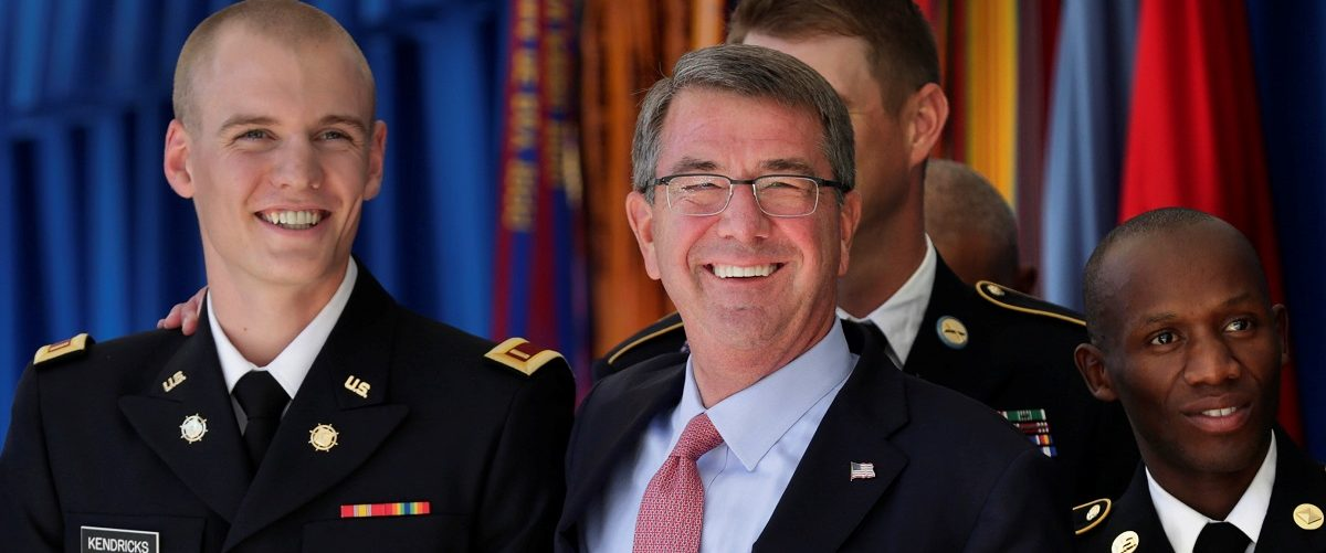 US Defence Secretary Ash Carter poses Army 2nd Lt. Sam Kendricks during a ceremony to recognize the 2016 Active Duty Military Olympians and Paralympians in Washington