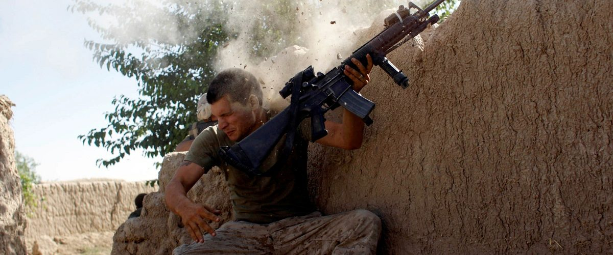Sgt. William Olas Bee, a U.S. Marine from the 24th Marine Expeditionary Unit, has a close call after Taliban fighters opened fire near Garmser in Helmand Province
