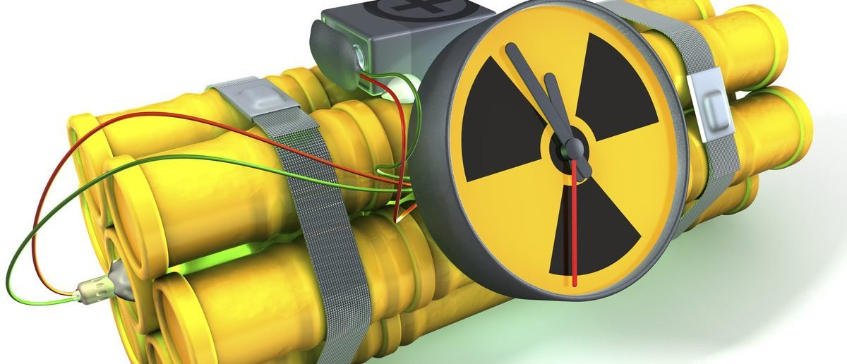Nuclear time bomb with a light green glow, 3d rendering on white background, isolated with shadow (Shutterstock/imagineerinx)