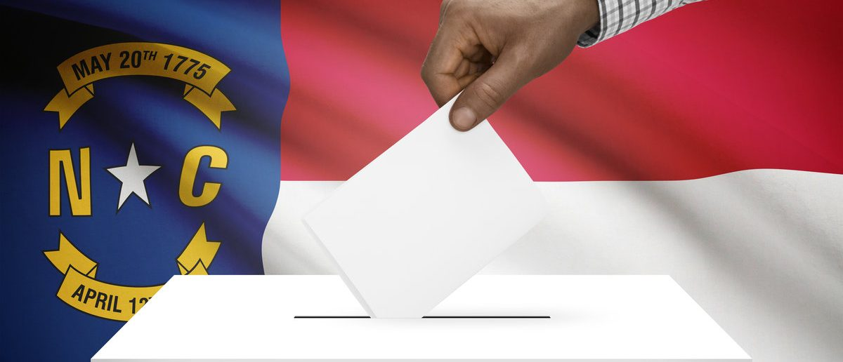 Voting concept - Ballot box with US state flag on background - North Carolina (Shutterstock/Niyazz)
