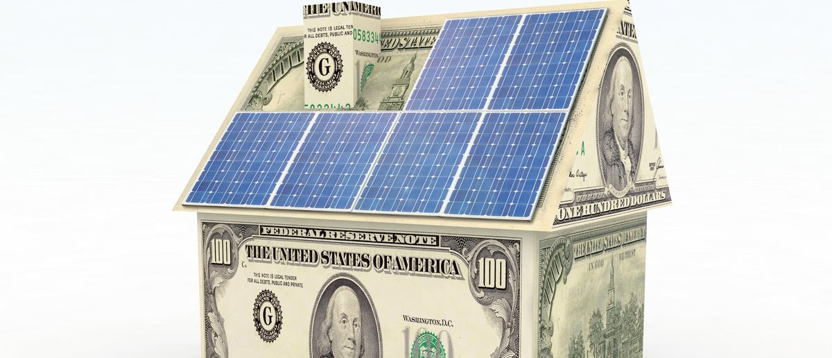 Money home with solar panel concept (Shutterstock/Fabio Berti)