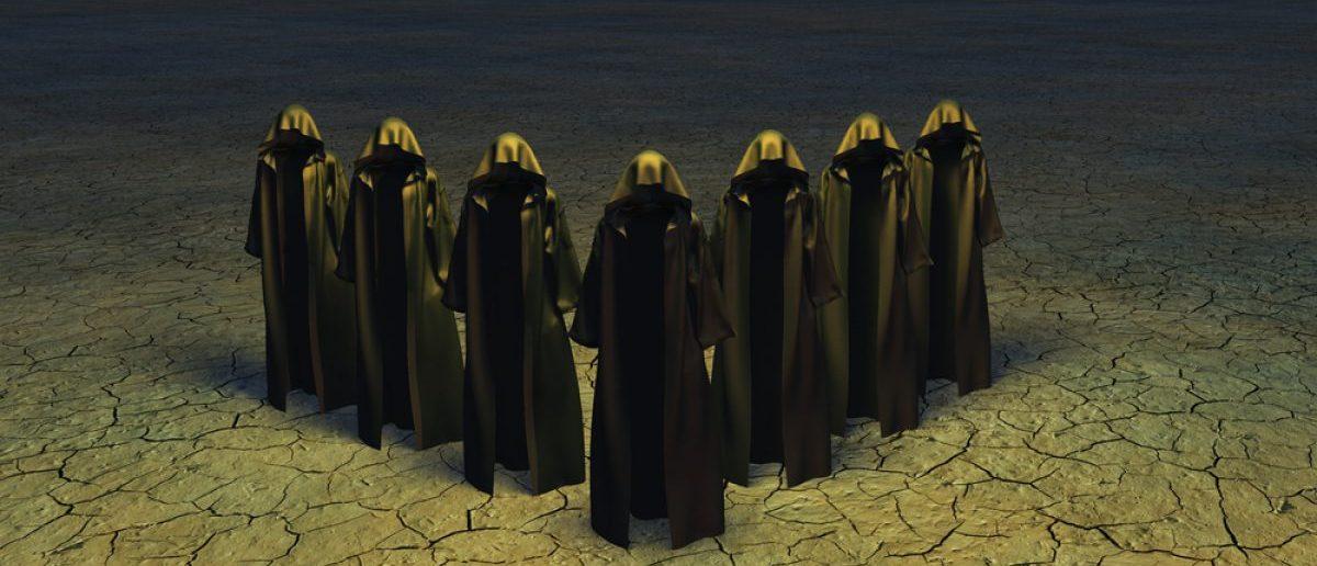 Hooded Figures [Shutterstock - Bruce Rolff]