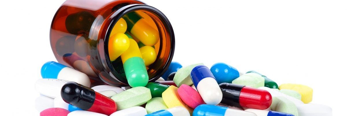 Tablets pills heap color mix therapy drugs doctor flu antibiotic pharmacy medicine medical. (Shutterstock/Chatkul)