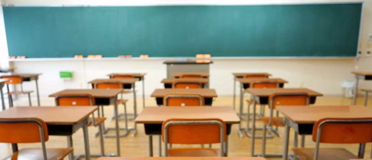 School classroom with school desks and blackboard in Japanese high school [maroke/Shutterstock]