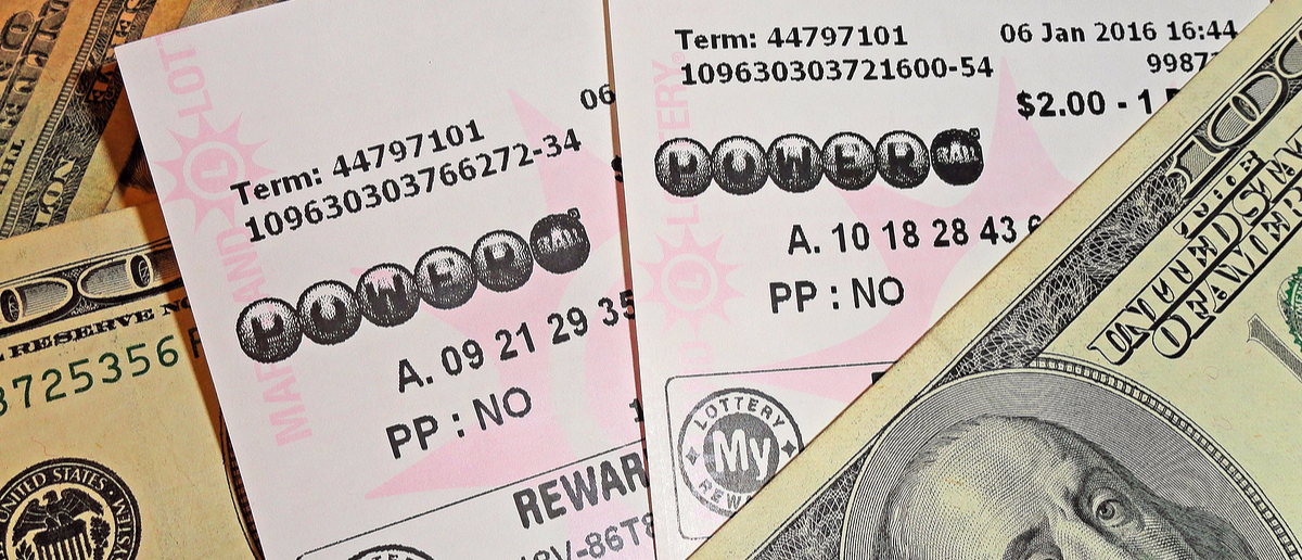 Powerball tickets and hundred dolla bills. Photo:Julie Clopper/Shutterstock