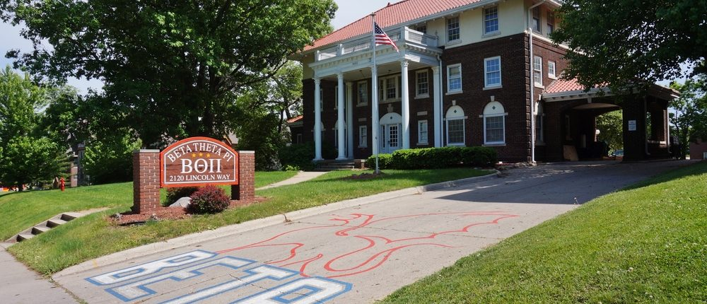 AMES, IA -25 MAY 2016- Fraternity and sorority houses with Greek letters on the campus of Iowa State University (of Science and Technology), a public research university located in Ames, Iowa. (Shutterstock)