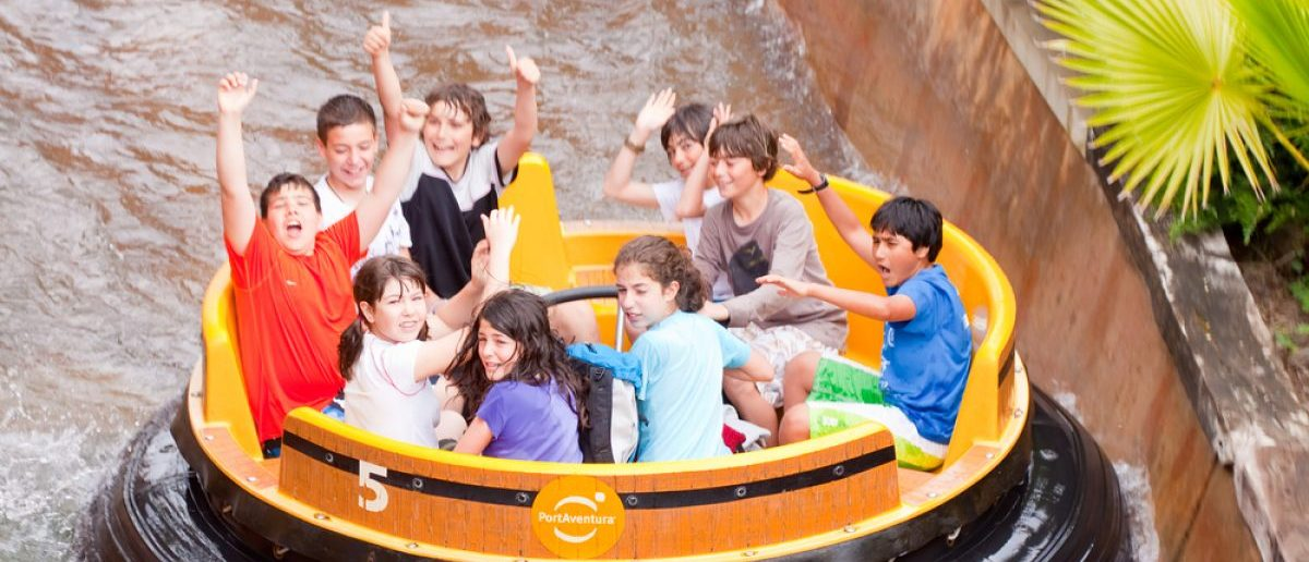 People ride at Theme Park in April 13, 2011 in Salou, Spain. Grand Canyon Rapids is one of most exhilarating rides in Old American West area at Port Aventura. [Shutterstock -