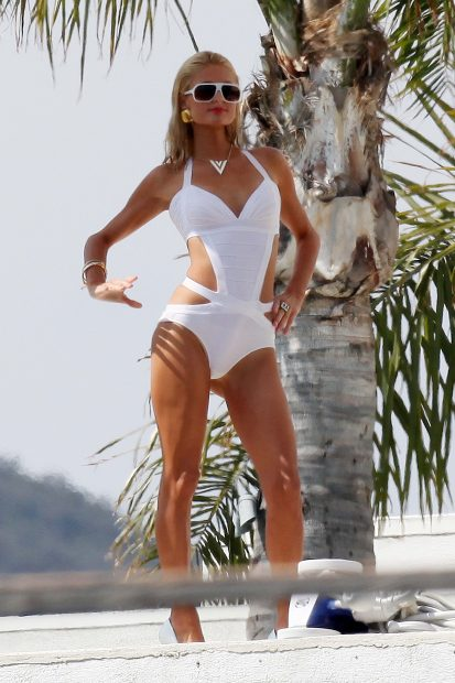 Paris Hilton looking amazing in a white one-piece. (Photo credit: Splash News)