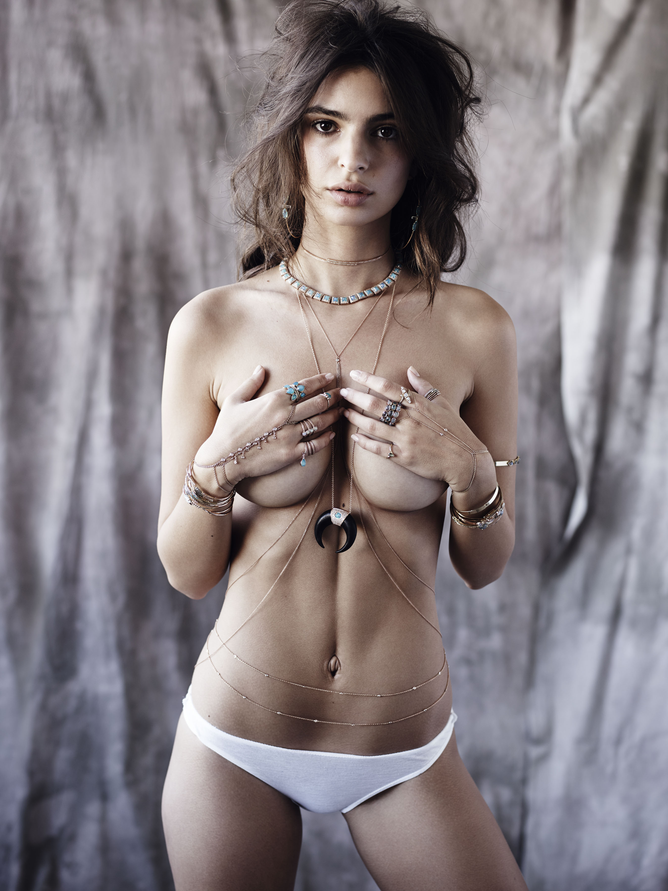 Emily Ratajkowski wearing a whole lot of jewelry and not much else. (Photo credit: Splash News)