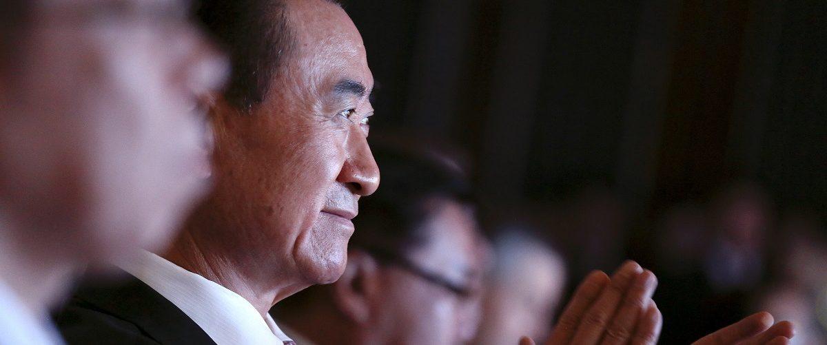 Wang Jianlin, the chairman of Dalian Wanda Group in China clap hands during an event announcing strategic partnership between Wanda Group and FIFA in Beijing