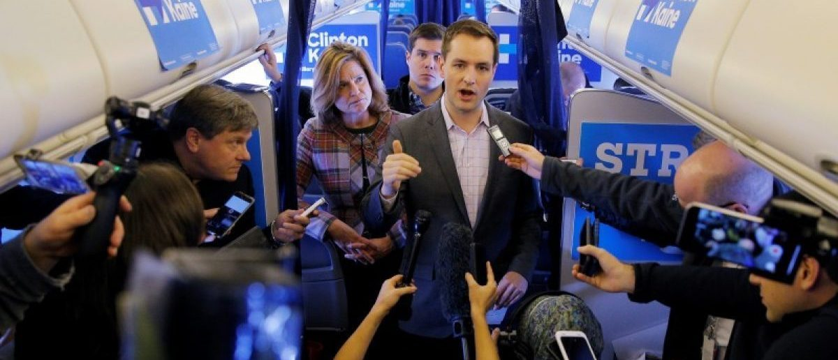 Robby Mook, Campaign Manager for U.S. Democratic presidential nominee Hillary Clinton, and Communications Director Jen Palmieri (L) talk to reporters onboard the campaign plane enroute to Cedar Rapids, Iowa, U.S. October 28, 2016. REUTERS/Brian Snyder