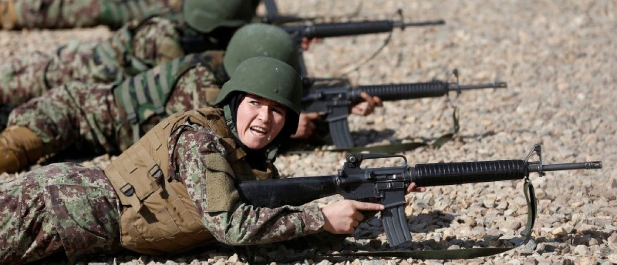 Sabera, 23, a soldier from the Afghan National Army (ANA) gestures during a shooting exercise at the Kabul Military Training Centre (KMTC) in Kabul, Afghanistan October 26, 2016. REUTERS/Mohammad Ismail SEARCH