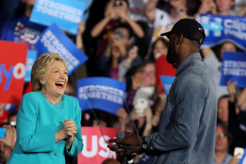 NBA basketball player Lebron James (R) introduces U.S. Democratic presidential nominee Hillary Clinton during a campaign rally in Cleveland, Ohio, U.S., November 6, 2016. REUTERS/Carlos Barria