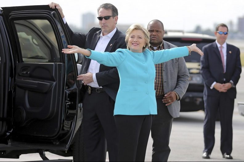 U.S. Democratic presidential candidate Hillary Clinton reacts before boarding her campaign plane at Miami international airport in Miami, Florida, U.S., October 26, 2016. REUTERS/Carlos Barria/File Photo