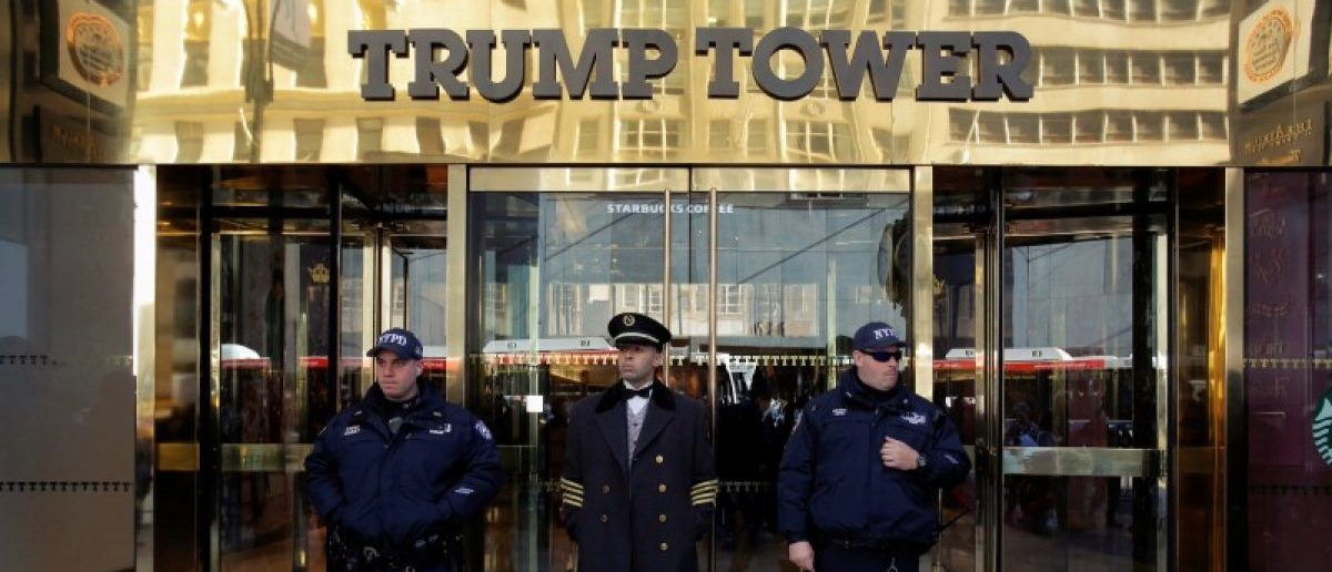 Members of the New York Police Department's Counterterrorism Bureau stand with a doorman outside U.S. Republican presidential nominee Donald Trump's Trump Tower ahead of the U.S. presidential election in Manhattan, New York, U.S., November 7, 2016. REUTERS/Andrew Kelly