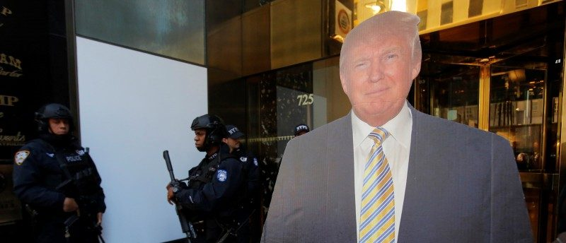 Members of the New York Police Department's Counterterrorism Bureau stand near a cutout of U.S. Republican presidential nominee Donald Trump outside Trump Tower ahead of the U.S. presidential election in Manhattan, New York