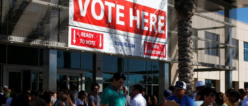 People line up to vote early outside the San Diego County Elections Office in San Diego, California