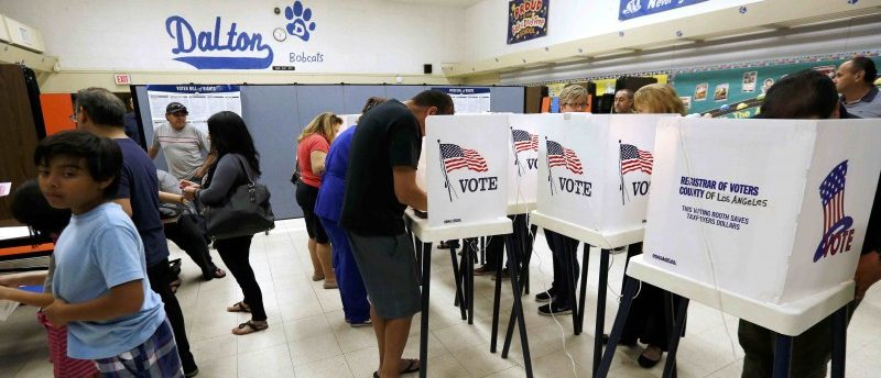 Voters cast their ballots in the Dalton Elementary School after the polling station in Azusa, California, U.S. was reopened following a shooting in the area during the U.S. presidential election November 8, 2016.  REUTERS/Mario Anzuoni