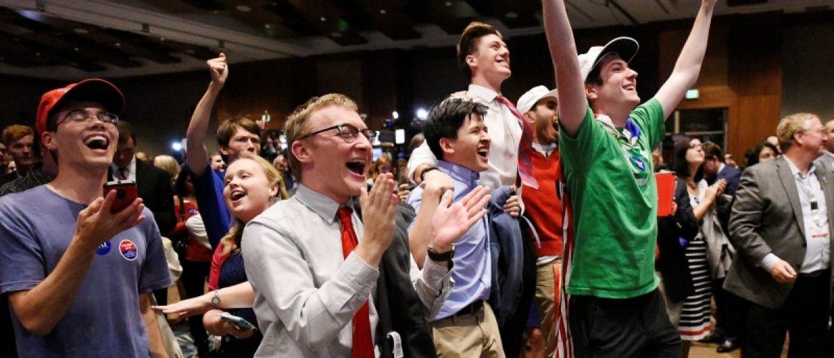 Supporters of U.S. Republican candidate Donald Trump celebrate after the networks called their candidate's victory in the state of North Carolina, at Republican Governor Pat McCrory's election-night party in Raleigh, North Carolina, U.S. November 8, 2016.  REUTERS/Jonathan Drake