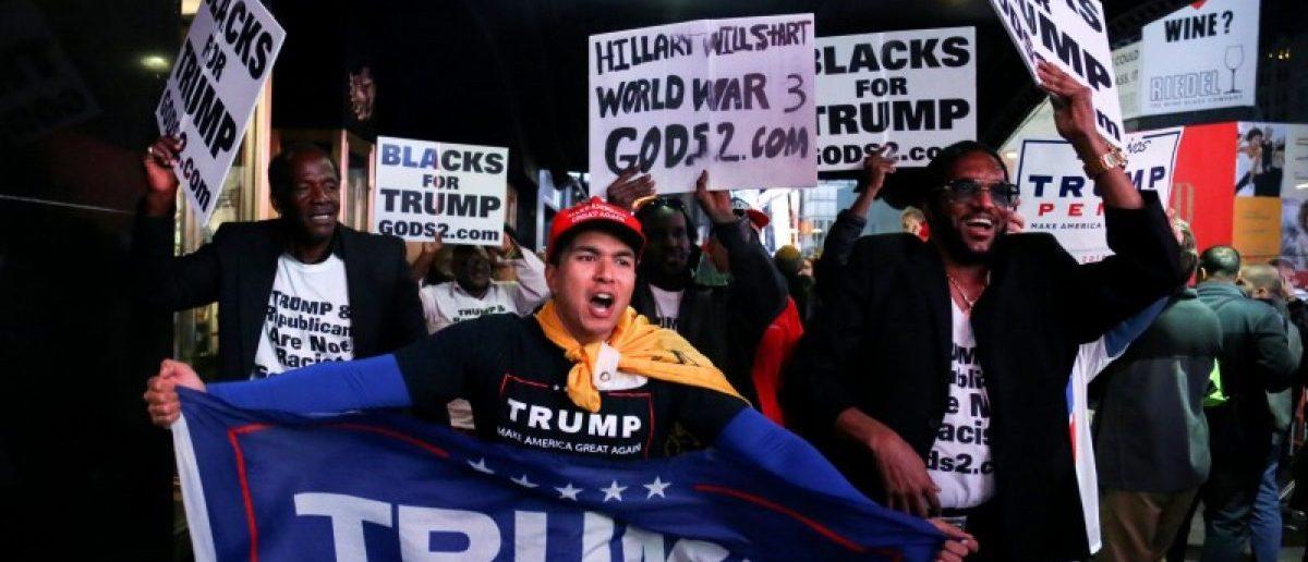 Supporters of U.S. President-elect Donald Trump rally through Times Square, Manhattan, New York, U.S. November 8, 2016. REUTERS/Bria Webb