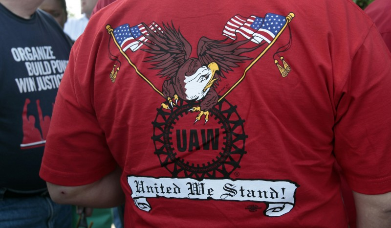 A United Auto Workers union member wears a shirt with 'UAW United We Stand' on it May 25, 2012. (Photo: REUTERS/Rebecca Cook)