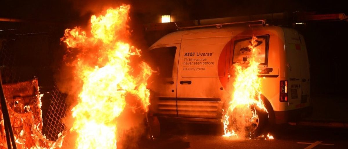 An ATT truck burns as protests riot in Oakland, California, U.S. following the election of Republican Donald Trump as President of the United States November 9, 2016.  REUTERS/Noah Berger