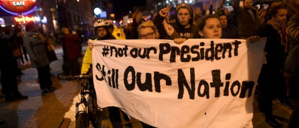Demonstrators protest in response to the election of Republican Donald Trump as the president of the United States in Philadelphia, Pennsylvania, U.S. November 11, 2016. REUTERS/Mark Makela
