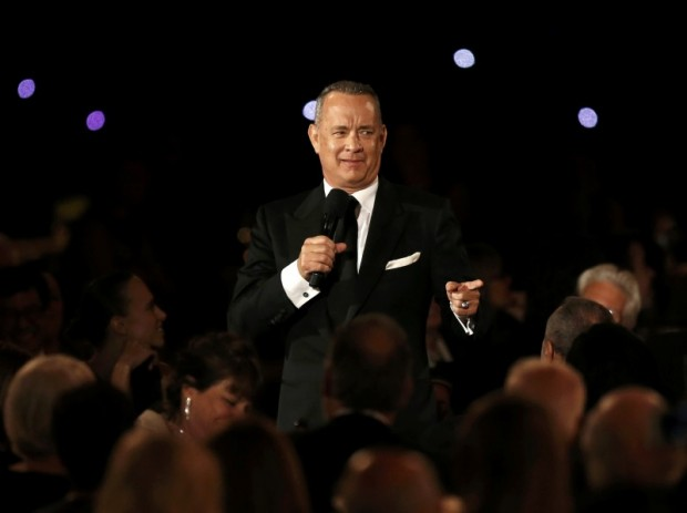 Actor Tom Hanks speaks while standing amid the audience at the 8th Annual Governors Awards in Los Angeles, California, U.S., November 12, 2016. REUTERS/Mario Anzuoni