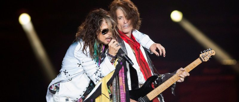 "Vocalist Steven Tyler (L) and guitarist Joe Perry of Aerosmith perform during their ""Aerosmith: Let Rock Rule"" tour at The Forum in Inglewood, California July 30, 2014. REUTERS/Mario Anzuoni/File photo"
