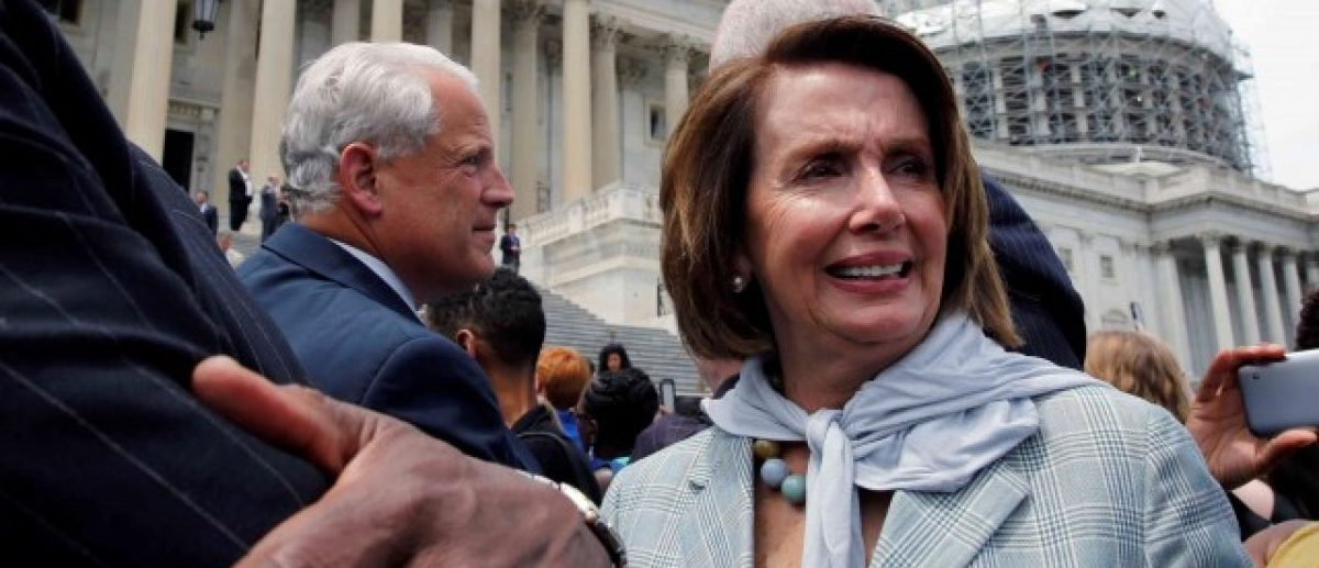 U.S. House Minority Leader Nancy Pelosi (D-CA) (R) and Rep. James Clyburn (D-SC) (L) walk out with House Democrats on Capitol Hill in Washington, U.S., after their sit-in over gun-control law, June 23, 2016. REUTERS/Yuri Gripas/File Photo