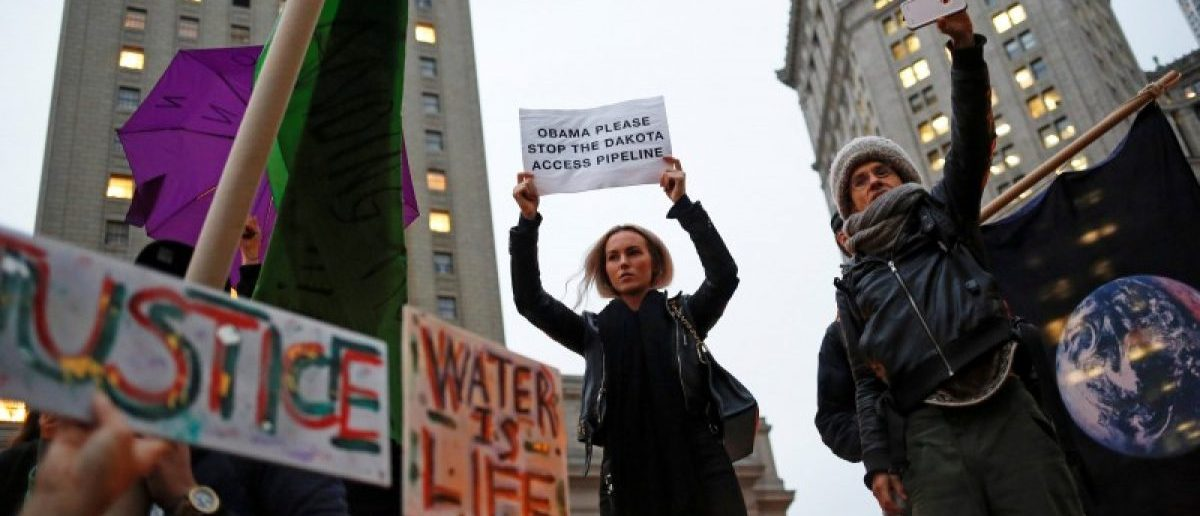 Demonstrators in New York gather to protest against plans to pass the Dakota Access pipeline near the Standing Rock Indian Reservation in North Dakota, U.S., November 15, 2016. REUTERS/Shannon Stapleton