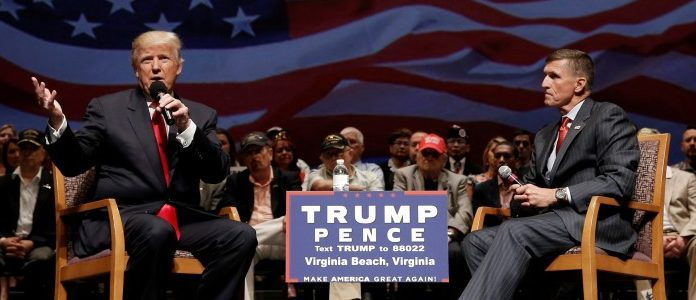 Republican presidential nominee Donald Trump (L) speaks along side retired U.S. Army Lieutenant  General Michael Flynn during a campaign town hall meeting in Virginia Beach, Virginia, U.S., September 6, 2016. REUTERS/Mike Segar/File Photo